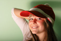 Young girl with Santa's red cap Stock Image