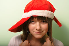 Young girl with Santa's red cap Stock Photography