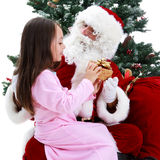 Young Girl and Santa Under Christmas tree Royalty Free Stock Images