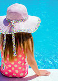 Young girl sat by the pool Stock Photography