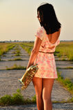 A young girl with a saxophone in his hands on the ground Royalty Free Stock Photography