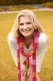 Young girl in a scarf in autumn park Royalty Free Stock Photos