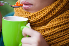 Young girl with scarf and a cup in his hand Royalty Free Stock Photos