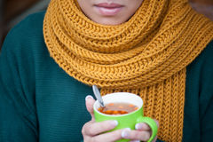 Young girl with scarf and a cup in his hand Royalty Free Stock Photography