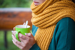 Young girl with scarf and a cup in his hand Royalty Free Stock Photo