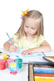 Young girl in school at the desk Royalty Free Stock Photo
