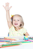 Young girl in school at the desk Stock Image