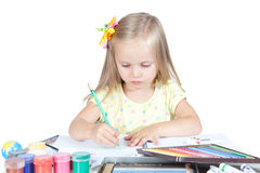 Young girl in school at the desk Stock Images