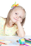 Young girl in school at the desk Royalty Free Stock Image