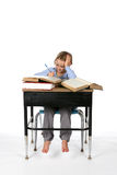 Young girl at at school desk Stock Photo