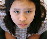 Young girl in school uniform paying attention Royalty Free Stock Photos