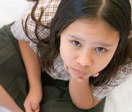 Young girl in school uniform paying attention Stock Photography