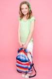Young girl with schoolbag posing in studio Royalty Free Stock Photos