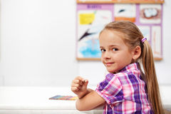 Young girl in science class Stock Photo
