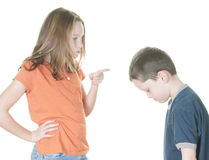 Young girl scolding boy Stock Photography