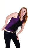 Young girl screaming. A pretty blond hair young woman in jeans and purple top, screaming Stock Photos