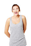 Young girl screaming. Young caucasian girl standing and screaming. Isolated on white Stock Image
