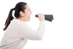 Young girl screaming in a paper loudspeaker Royalty Free Stock Image