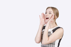 Young girl screams Stock Image