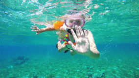 Young girl scuba diver stock footage