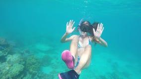 Young girl scuba diver stock video