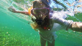 Young girl scuba diver stock video footage