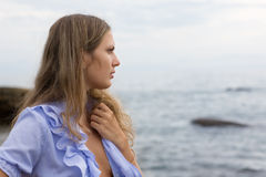 Young girl by the sea Royalty Free Stock Image