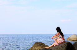 Young girl on the sea beach Stock Images