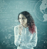 The young girl. Search a solution to solve math  problems Royalty Free Stock Photo
