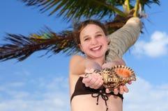 Young girl with seashell stock image