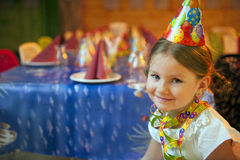 Young girl seated at her birthday table Stock Photography