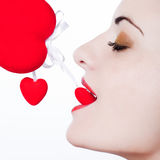 Young girl seductress. Young beautiful caucasian woman playing with heart and love Stock Image