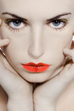 Young girl seductress. Young beautiful caucasian woman playing with heart drawing on lips Royalty Free Stock Images