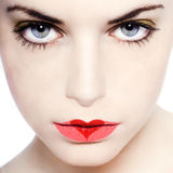 Young girl seductress. Young beautiful caucasian woman playing with heart drawing on lips Royalty Free Stock Image