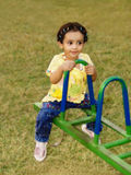 Young girl on seesaw  Royalty Free Stock Photography