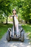 Young Girl on Segway. Young girl ride on segway in summer park stock photography