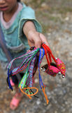 Young girl selling homemade colorful bracelets in Sapa, Vietnam Stock Photo
