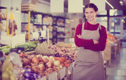 Young girl selling onion and smiling Stock Photography
