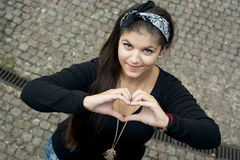Young girl sending love heart Royalty Free Stock Image