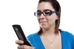 Young girl sending a text message Royalty Free Stock Photography