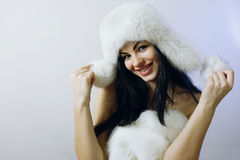 Young girl with several natural fur coats Stock Image