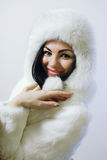 Young girl with several natural fur coats Stock Photo