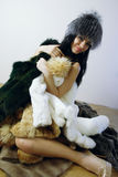 Young girl with several natural fur coats Royalty Free Stock Photography