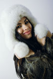 Young girl with several natural fur coats Royalty Free Stock Photos