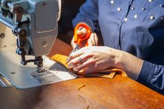 Young woman tailoring on the sewing machine stock photos