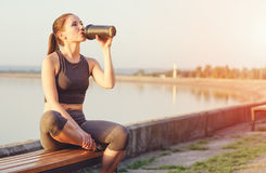 Young girl with a shaker water outdoors Stock Photo