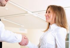 Young girl shakes hands Royalty Free Stock Photo
