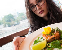 Young girl sharing food Stock Photo