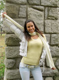 Young girl with shawl along the stone wall Stock Photography