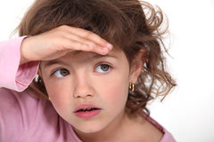 Young girl shielding her eyes Royalty Free Stock Images